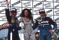 Podium: race winner Michele Alboreto, Tyrell Ford, World Champion Keke Rosberg, Williams Ford