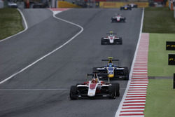 Charles Leclerc, ART Grand Prix leads Jake Hughes, DAMS