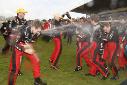 Race winners Garth Tander and Warren Luff, Holden Racing Team celebrate with the team