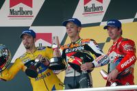 MotoGP Photos - Podium: race winner Valentino Rossi, Repsol Honda Team, second place Max Biaggi, Pramac Pons, third place Troy Bayliss, Ducati Team