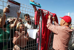 Niki Lauda, Mercedes Non-Executive Chairman signs autographs for the fans