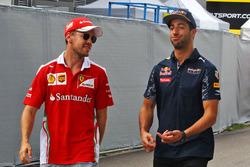 Sebastian Vettel, Ferrari with Daniel Ricciardo, Red Bull Racing