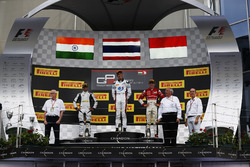 Alexander Albon, ART Grand Prix Oscar Tunjo, Jenzer Motorsport and Charles Leclerc, ART Grand Prix stand on the podium