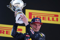 Formula 1 Photos - Race winner Max Verstappen, Red Bull Racing celebrates on the podium