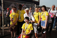 Formula 1 Photos - Bernie Ecclestone, with Starlight children