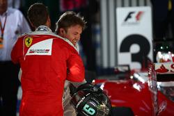 Third place Sebastian Vettel, Ferrari and winner Nico Rosberg, Mercedes AMG F1 Team in parc ferme
