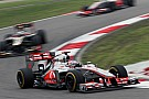 McLaren's Button and Hamilton battle rivals for Chinese GP podium