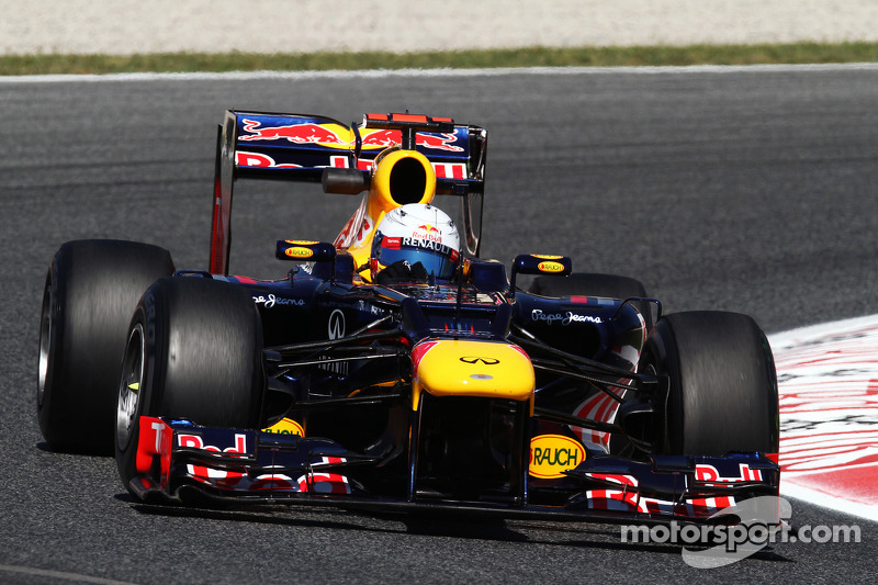 'Improving' Vettel happy at Red Bull