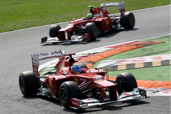 Massa succumbs to team orders, Button still fighting