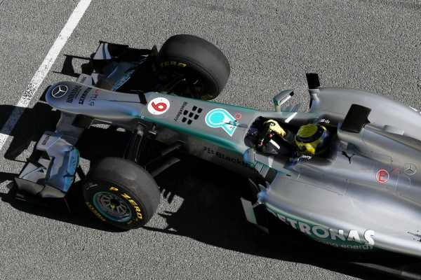 Hamilton watches Rosberg debut 2013 car