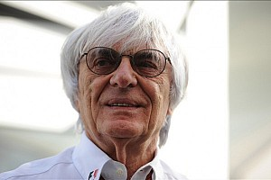 Ecclestone smiles, jokes as bribery trial begins