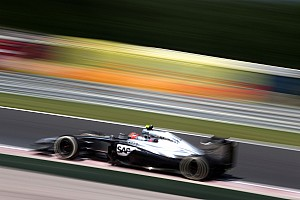 Formula 1 Qualifying report Button will start from the clean side of the grid on tomorrow's Hungarian GP