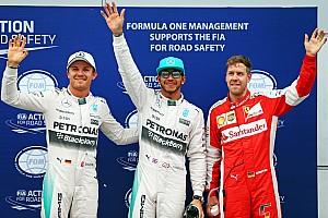 Hamilton takes Malaysian GP pole, as Vettel splits Mercedes