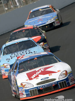Jimmy Spencer in his Kmart Ford Taurus leads his teammate Todd Bodine through turn one