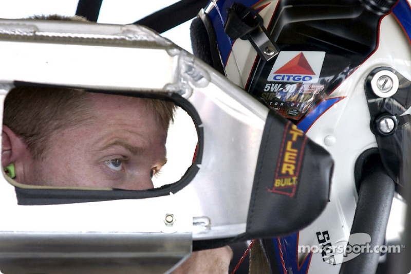 Jeff Burton keep his eyes on the competition through the hole in the head protection brace