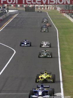 Kimi Raikkonen leading Jean Alesi