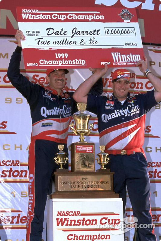 Winston Cup champions: Dale Jarrett and crew chief Todd Parrott after winning the 1999 title and its $2 million bonus