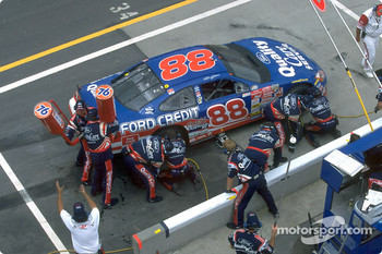 The Robert Yates Racing pit crew, led by Todd Parrott, at work on Dale Jarrett's Taurus