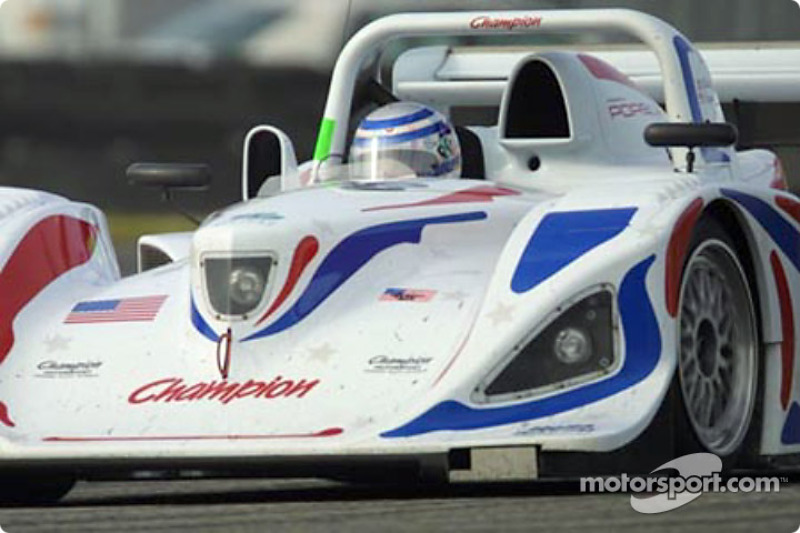 The Champion Racing Porsche Lola takes a turn at Daytona International Speedway during the Grand-Am Finale weekend