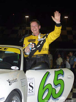 David Haskell waves to friends and family as he exits the #65 Speedsource Porsche in Victory Lane at the Grand-Am Finale