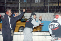 The TF Racing cheers on its driver as he crosses the finish line with his hood up to take second place