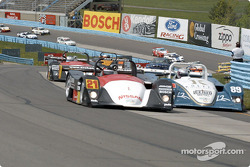 Andy Lally in the Archangel Motorsport Services Nissan Lola leading the pack through the esses
