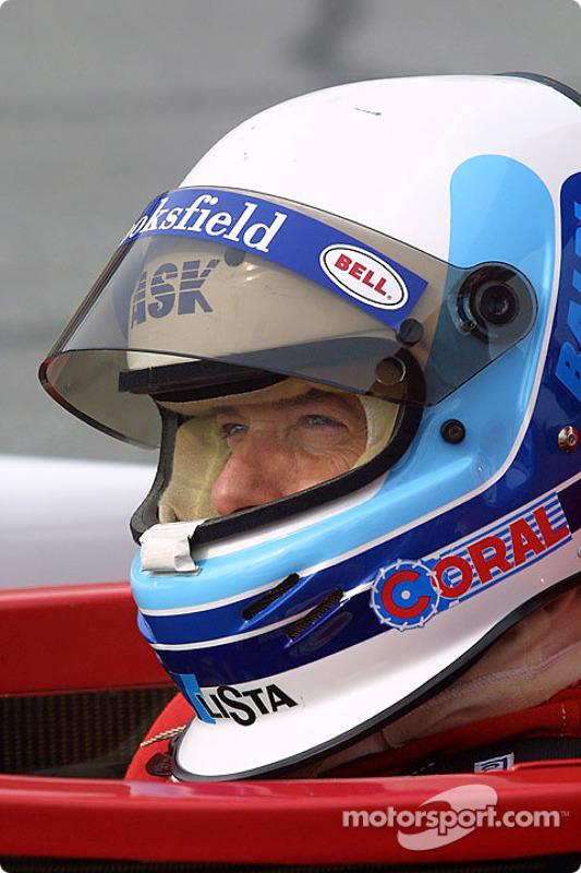 Dallara driver Mauro Baldi sits in his car at Daytona during Saturday's Grand-Am testing