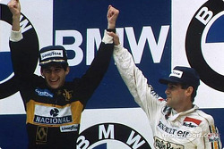 Winner Ayrton Senna with Patrick Tambay on the podium