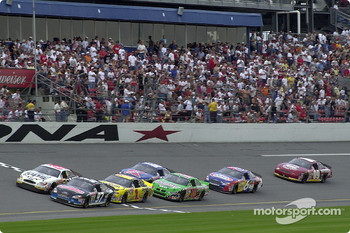 Kurt Busch and Dale Jarrett race past the stands during the season opening Bud Shootout
