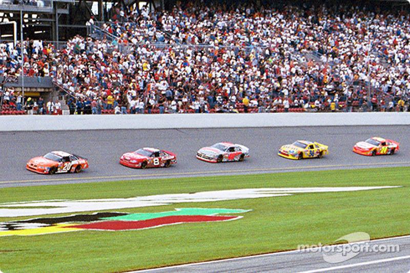 Tony Stewart leading Dale Earnhardt Jr. and the field