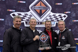 Dale Jarrett presents Motorcraft truck driver Barry Sheppard his trophy for winning the first of four International Truck Challenges