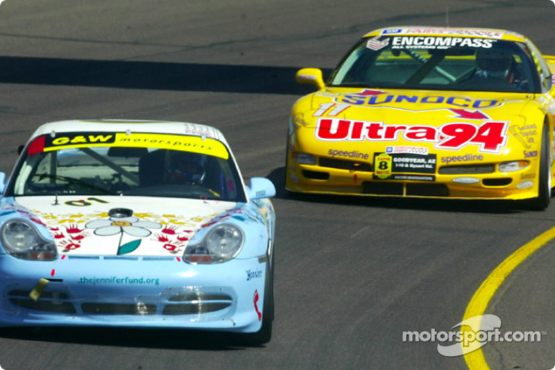 The #01 Jennifer Fund Porsche GT3 Cup of Darren Law leads the Powell Motorsports Chevrolet Corvette in the early stages of the race
