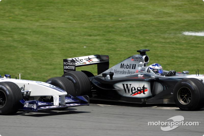 Kimi Raikkonen passing Ralf Schumacher