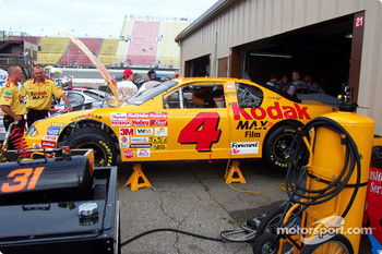 Mike Skinner Kodak Chevy being worked on by team in garage