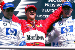 The podium: race winner Michael Schumacher with Juan Pablo Montoya and Ralf Schumacher