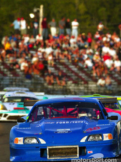 Fans watch as the AGT-winning #48 Mustang of Heritage Motorsports leads a group of cars