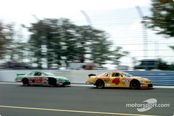 Mike Skinner leads Bobby Labonte down the front straight