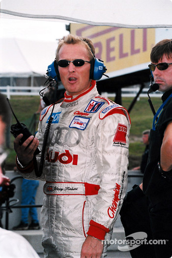 Johnny Herbert listens to practice