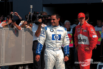 Pole winner Juan Pablo Montoya and Michael Schumacher