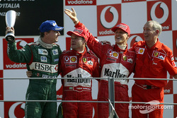 The podium: race winner Rubens Barrichello with Michael Schumacher and Eddie Irvine