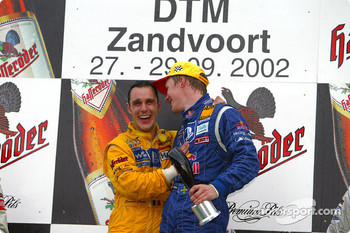The podium: race winner Mattias Ekstrm with DTM 2002 Champion Laurent Aiello