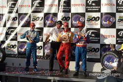 The podium: race winner Jimmy Vasser with Bobby Rahal, Michael Andretti and Patrick Carpentier