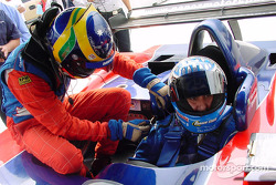David Brabham helps Mexican driver Jimmy Morales buckle into the Panoz for some laps