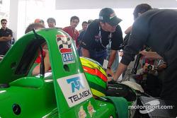 Luis Diaz and Adrian Fernandez in Fernandez Racing pit area