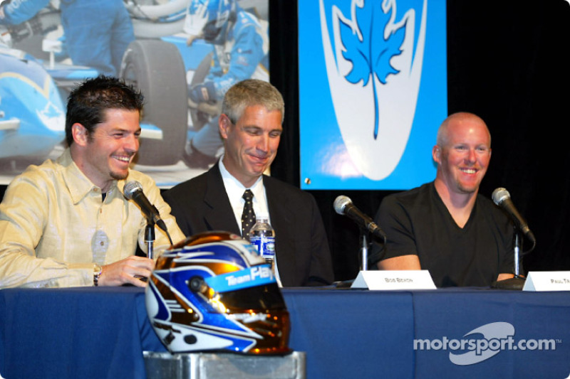 Team Player's announces their driver line up for 2003: President of Player's Ltd. Bob Bexon (centre) welcomes Canadians Patrick Carpentier and Paul Tracy to the all Canadian team for the 2003 CART season