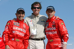 Jean-Pierre Fontenay and Gilles Picard celebrate with Dakar Rally organiser Hubert Auriol