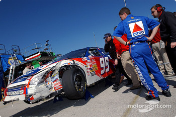 Paul Andrews, crew chief of the Citgo Ford Taurus surveys the damage to the car after driver Jeff Burton got caught up in a 5 car wreck during practice