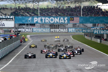 The start: Fernando Alonso leads the field