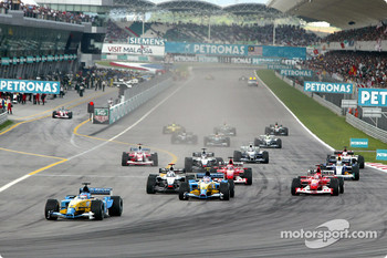 First corner: Fernando Alonso leads the field
