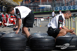 BAR team members prepare the tires